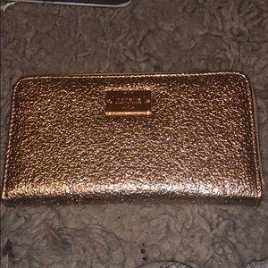 Brand new metallic wallet in rose gold